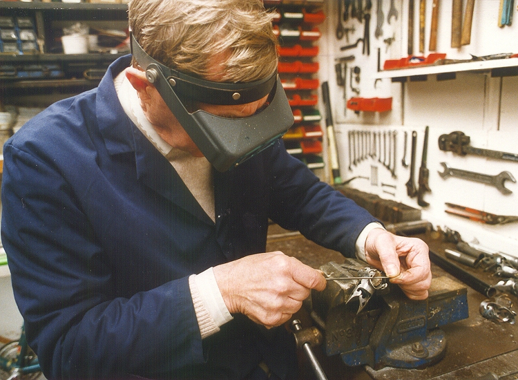 Full size image of Trevor Jarvis filing lugs in the workshop